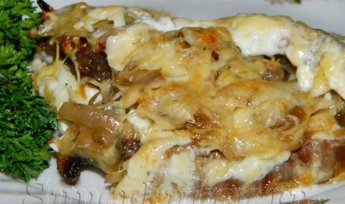 Телятина, запеченная в духовке с грибами и сыром по-нормандски
